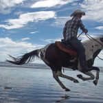 NICARAGUA: RIDING HORSES THROUGH THE WAVES