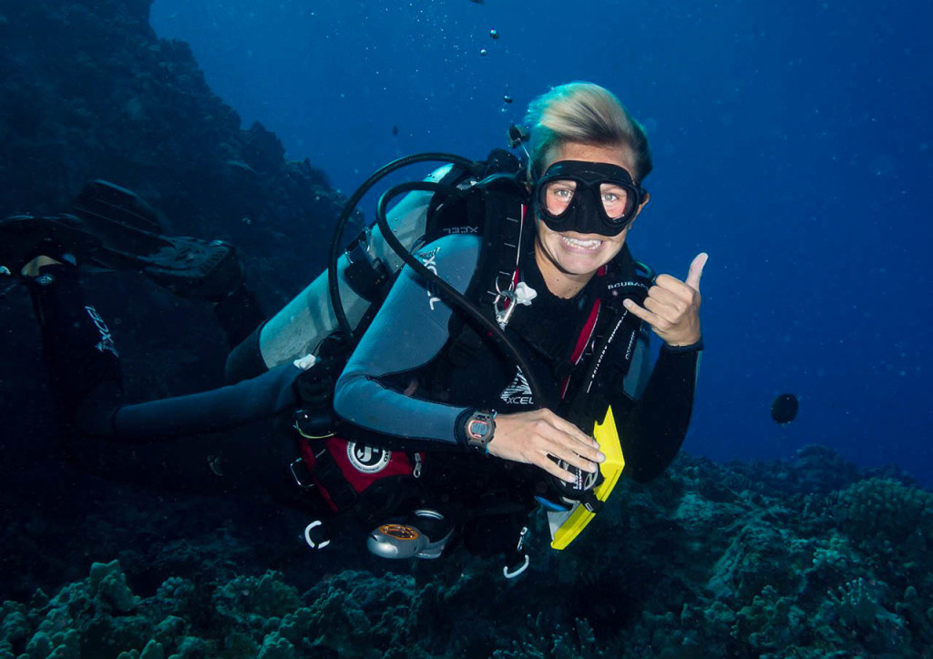 Christine West, fins to spurs, diner with travelers, Scuba dive