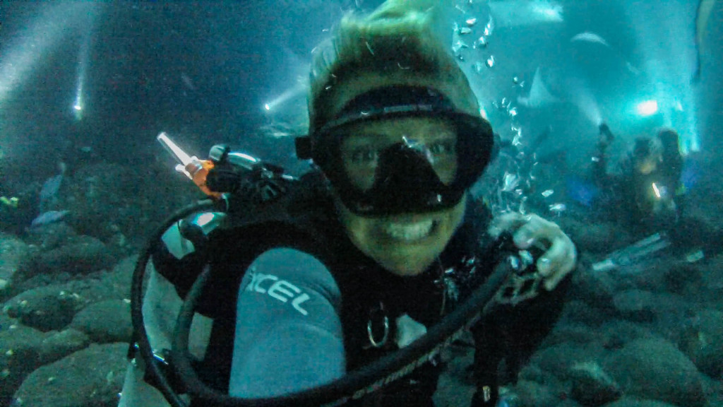 Christine West, Fins to spurs, divemaster on night manta ray dive, kona, hawaii, Christine smiles