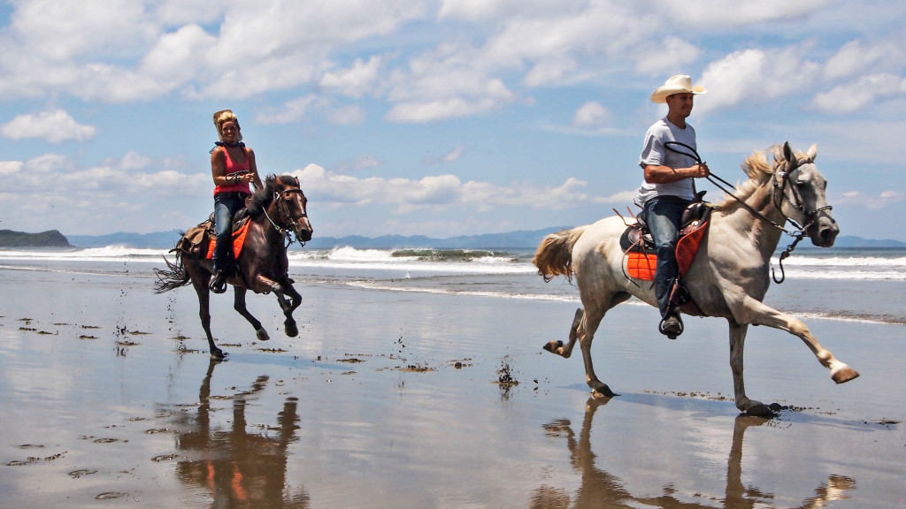 Christine west, Adam Maire, fins to spurs, guiding horsback adventure rours, san juan del sur, nicaragua, beach run